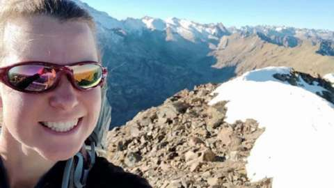 Esther Dingley on top of a mountain
