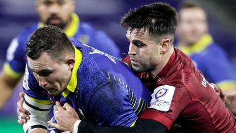 Paul Jedrasiak is tackled by Conor Murray