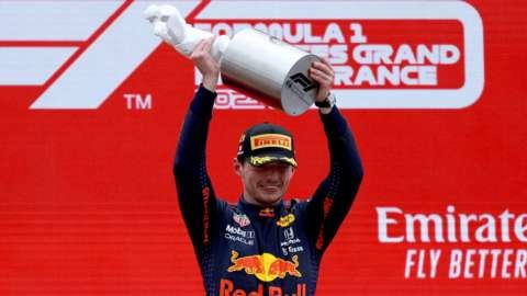 Max Verstappen holds the French Grand Prix winner's trophy aloft