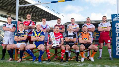 Super League in 2020 - players from all 12 clubs stand under the post for a promotional shot