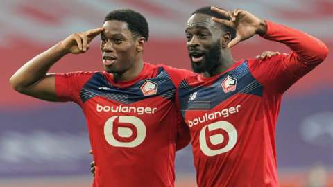 Lille's players celebrate after scoring against Marseille