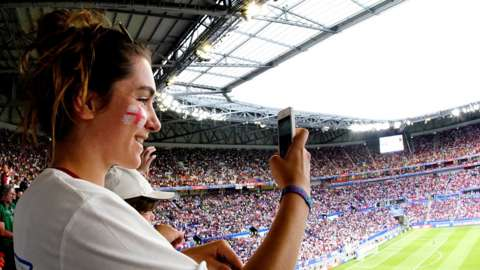 England fan takes picture of packed stadium