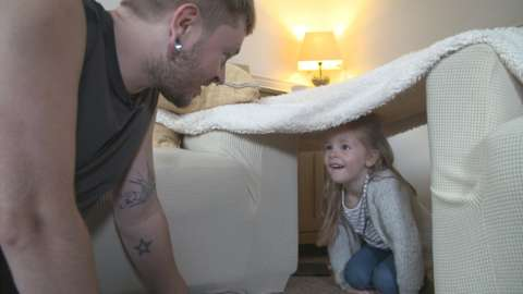 A father and daughter make a 'dad den'