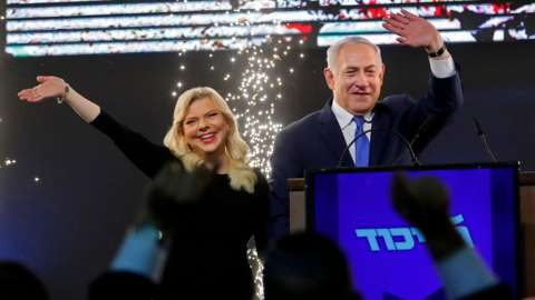 Benjamin Netanyahu and his wife Sara greet Likud supporters at the party's headquarters in Tel Aviv on 10 April 2019