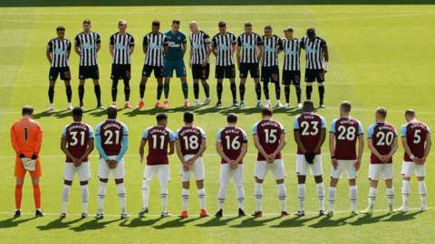 A minute's silence is held before the Premier League match between Newcastle and West Ham