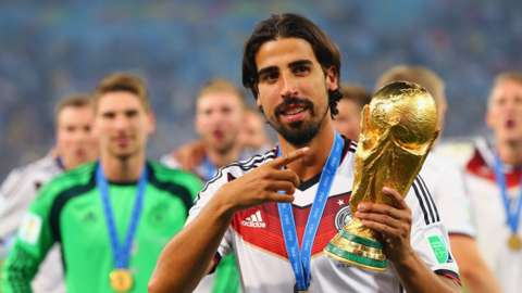 Sami Khedira with the World Cup trophy in 2014
