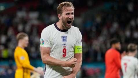 Harry Kane celebrates with England fans