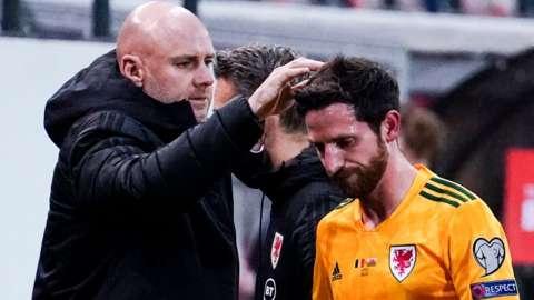 Wales boss Robert Page consoles Joe Allen