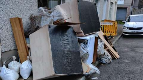 Ruined furniture piled up in the street