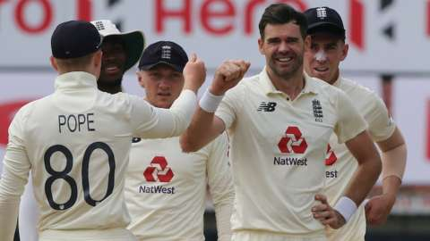 James Anderson celebrates with England team-mates