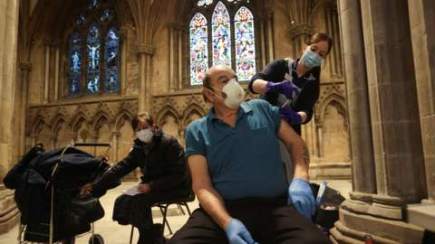 A man receives a coronavirus vaccination at Lichfield Cathedral