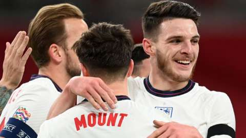 Declan Rice (right) celebrates an England goal against Iceland in a Nations League game at Wembley