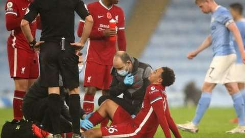 Trent Alexander-Arnold is treated after picking up an injury against Manchester City