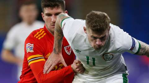 Republic of Ireland's James McClean (right) challenges Chris Mepham of Wales