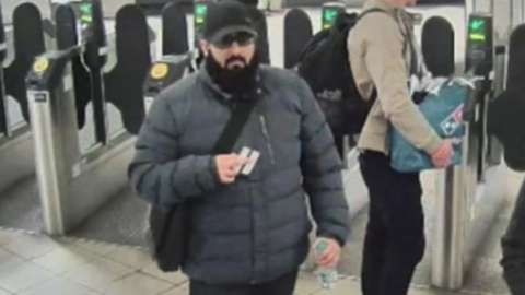 Khan passing through London Underground