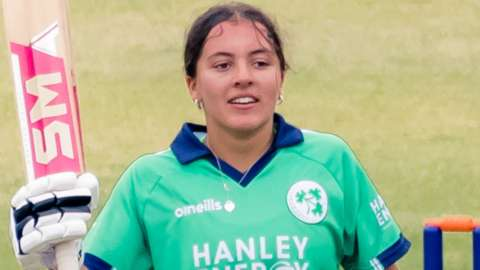 The Belfast schoolgirl acknowledges the applause after notching her century on Monday