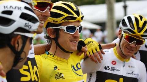 Geraint Thomas celebrates winning the 2018 Tour de France with his Team Sky team-mates