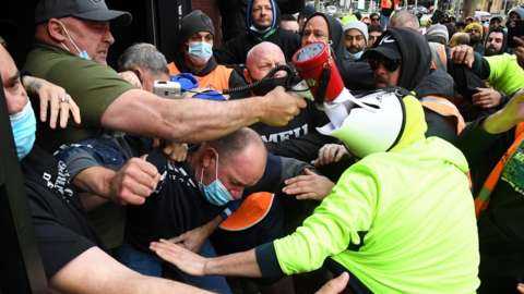 Construction workers clash with industry union members at a protest at Construction, Forestry, Maritime, Mining and Energy Union (CFMEU) headquarters in Melbourne
