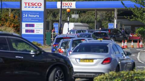Cars queuing for fuel in Stanwell, Surrey