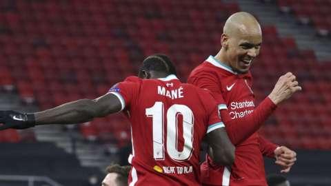 Fabinho (right) celebrates with Sadio Mane