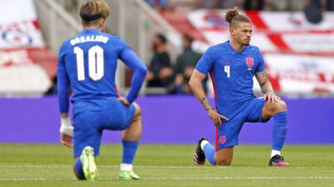 England players taking the knee