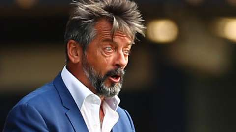 Phil Brown on the sidelines