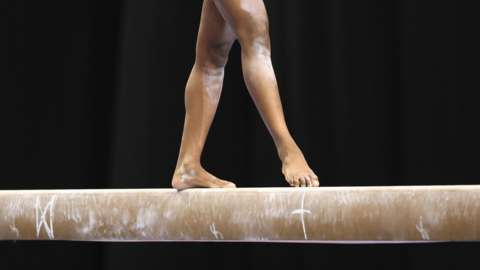 A gymnast on the beam