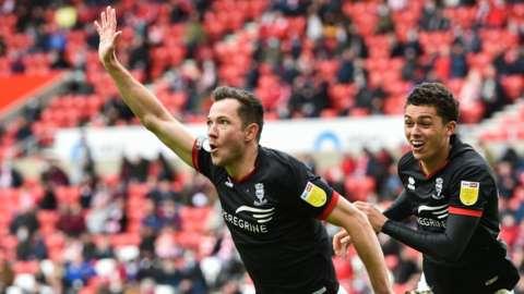 Tom Hopper leads the celebrations after scoring for Lincoln against Sunderland
