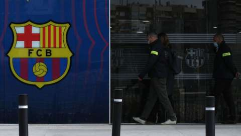 Police officers enter Barcelona's club offices