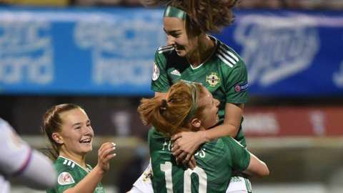 Chloe McCarron is held aloft by fellow goalscorer Rachel Furness after netting a glorious strike in Northern Ireland's win over the Faroe Islands