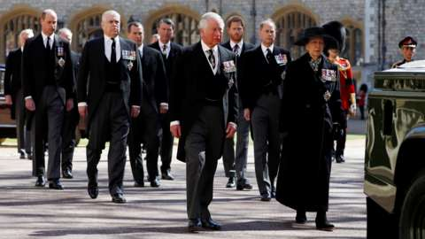 Prince Charles, Princess Anne and members of the Royal Family walk behind the hearse on the grounds of Windsor Castle during the funeral of Prince Philip, husband of Queen Elizabeth, who died at the age of 99, in Windsor