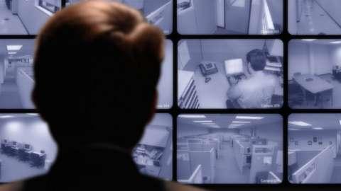 Man looking at screens