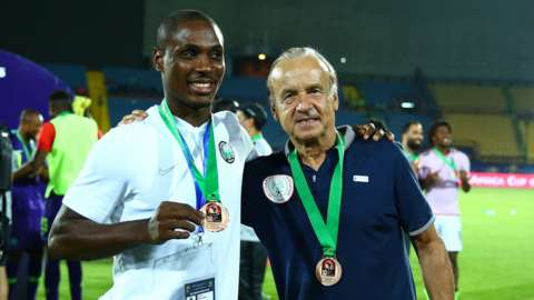 Nigeria striker Odion Ighalo (left) with coach Gernot Rohr after winning bronze at the 2019 Africa Cup of Nations
