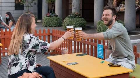 People drinking outside in London