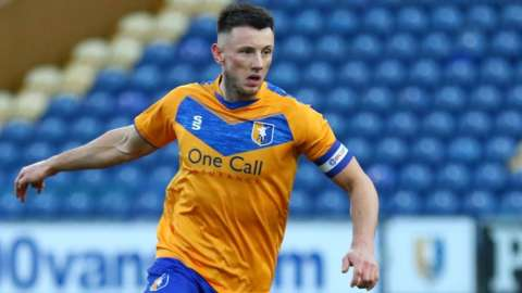 Ollie Clarke in action for Mansfield Town