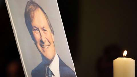 """A picture of Sir David Amess at a service of reflection at the church of St Michael""""s and all Angels, in Leigh-on-Sea"""