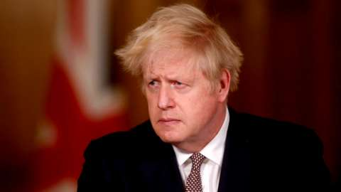 Boris Johnson attends a news conference on the ongoing situation with the coronavirus disease
