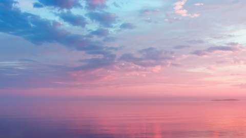 Purple and pink sunset over water