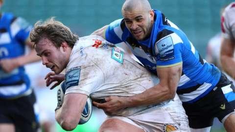 Jonny Gray holds of Jonathan Joseph to score for Exeter