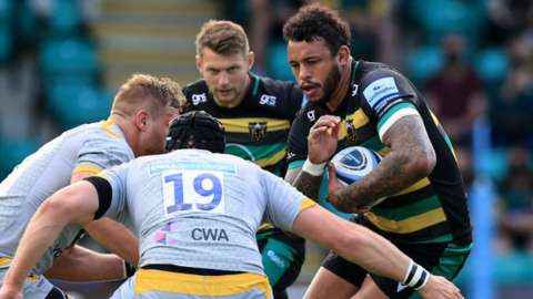 Courtney Lawes runs with the ball for Northampton