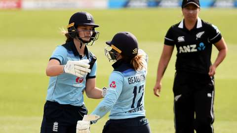 England batters Amy Jones (left) and Tammy Beaumont (right) celebrate beating New Zealand in the second ODI