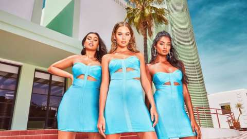 Boohoo models wearing a blue dress