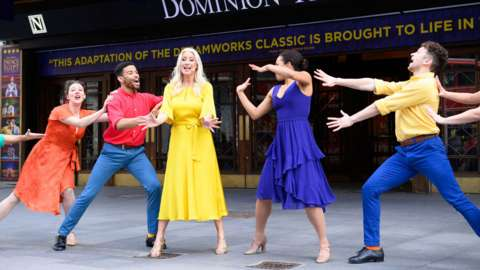 Denise Van Outen and other performers outside the Dominion Theatre in London on 5 May to mark the reopening of theatres