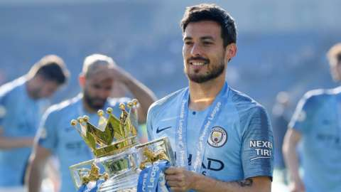 Manchester City's David Silva with the Premier League trophy