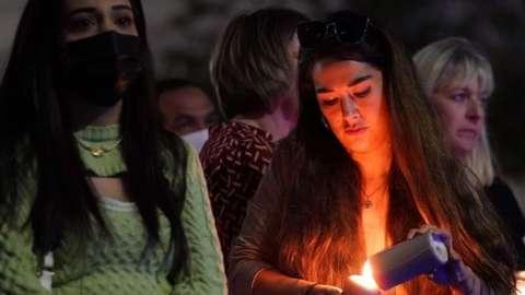 Members of the public attend a vigil in memory of Sabina Nessa,