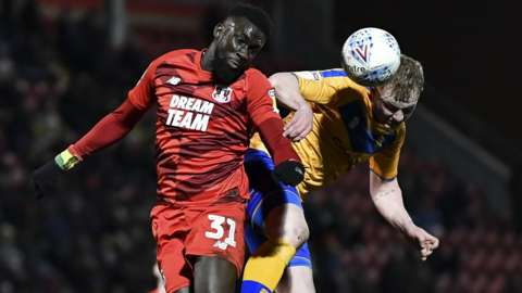 Ousseynou Cisse (left) playing against Mansfield