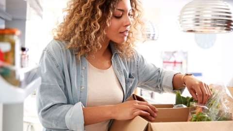 Woman opening food delivery