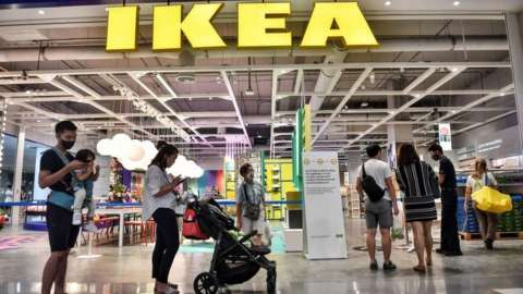 People queue outside Ikea in Bangkok