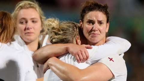 England captain Sarah Hunter embraces a team-mate after defeat by New Zealand in the World Cup final