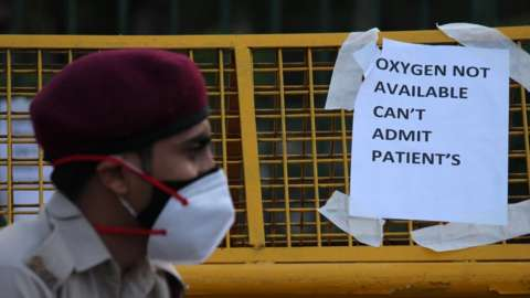 A notice pasted outside a makeshift isolation facility reads 'OXYGEN NOT AVAILABLE, CAN'T ADMIT PATIENTS', amid the rising coronavirus cases in New Delhi, India on April 23, 2021